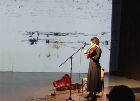 Anna Atkinson (visible) in performance with Brent Lee